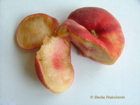 cut saturn peach in a dish